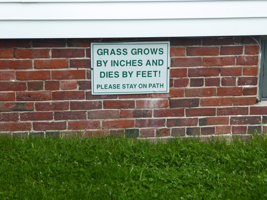 Grass grows by inches and dies by feet