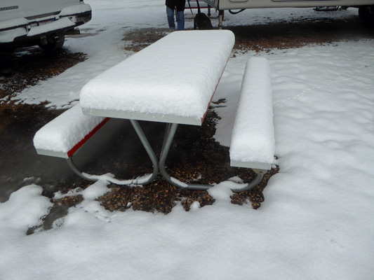 Picnic table in deep snow