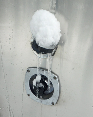 Icicles on Airstream trailer water inlet