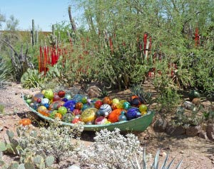 Boat full of Chihuly colored balls Phoenix Botanical Garden