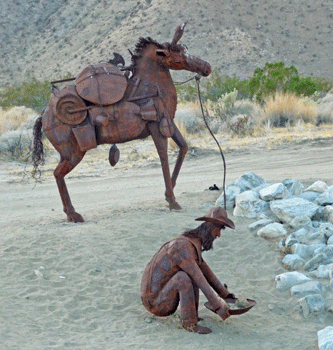 Old miner and his mule sculpture Borrego Springs CA