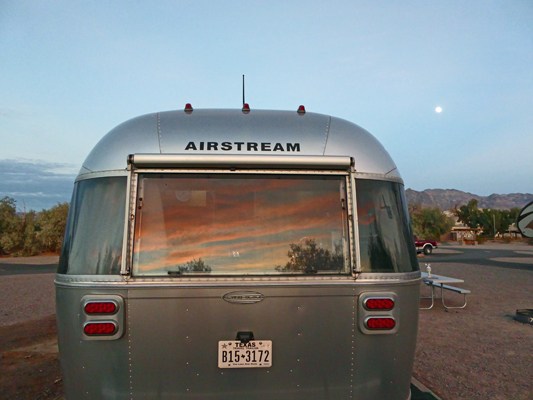 Sunset on Genevieve Airstream plus full moon
