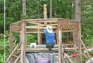 Walter Cooke removing kingpost from gazebo