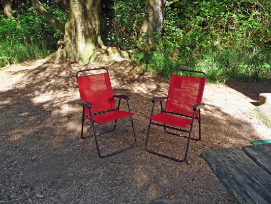 Red chairs in campsite