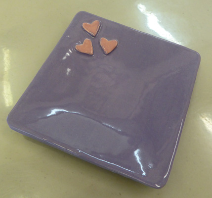 Hearts on a lavender jewelry dish.
