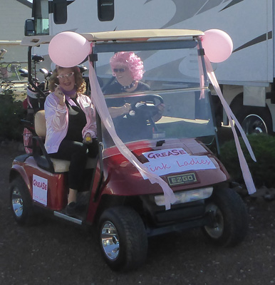 Decorated golf cart and golfers