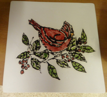Trivet with cardinal in berry bush
