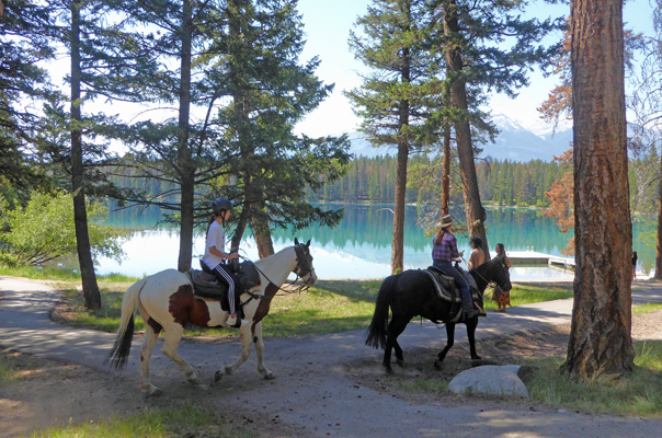 Horseback riders at Lake Annette