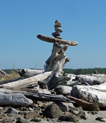 Rock and driftwood cairn South Jetty