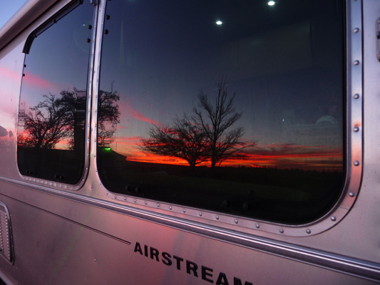 Sunset reflected in Genevieve Airstream's windows