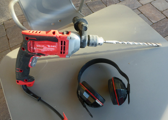 "Hammer drill with 12"" bit"