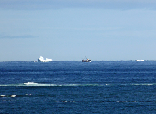 2 icebergs and fishing boat